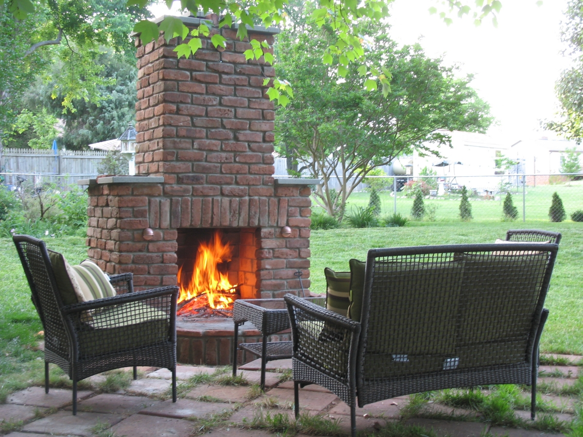 Outdoor Fireplace Pebbles : Outdoor seating area with stone fireplace and pebble